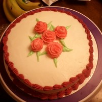I Never Promised You A Rose Garden White cake with buttercream and royal icing (borders and leaves only).