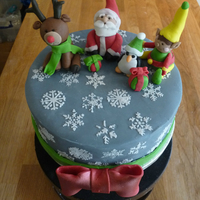 Christmas Fruit Cake Made For A Friend White Stencil Snow Flakes With Santa And His Helpers Made From Modified Fondant Bow Was Sprayed W Christmas fruit cake made for a friend. White stencil snow flakes with Santa and his helpers made from modified fondant. Bow was sprayed...