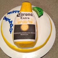 Corona Beer Bottle Cake  Traditional chocolate cake bottle with butter cake bottom layer. Lime is chocolate cake. All covered in MMF. So glad I started using lemon...