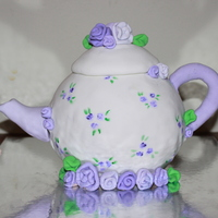 Teapot Cake! So this is the second fondant cake i've ever made! It started as a disaster!!! My oven obviously just does not work. A 35 minute cake...