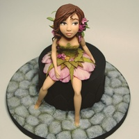 Forest Girl This is my new project, a sugarpaste modeling with lace application on the dress.…Este é o meu novo projecto,...