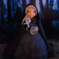 Witch Halloween is coming… Sculpted cake with lace applications and cristal ball made from isomalt.