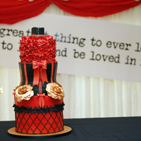 Moulin Rouge Theme Cake Moulin Rouge theme cake in black and red finished off with gold peonies. The cake was made to celebrate 21st birthday. The cake was serving...