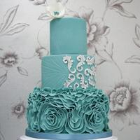 Teal Ruffles Wedding Cake Teal ruffle wedding cake inspired by a photo from a customer.