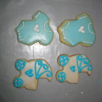 My Baby Shower Cookies  These are my first attempt at decorated cookies. They are NFSC recipe with a glaze that was featured here a while back. (I don't know...