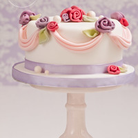 Rolled Roses Cake Cute little cake with fondant roses, drapes and pearls… simple yet effective :)