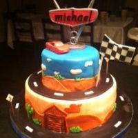 Everything On This Cake Is Edible Including Lightening Mcqueen Which Is Made Of Fondant Everything on this cake is edible including Lightening McQueen which is made of fondant.