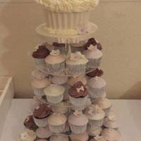 Vintage Inspired Giant Cupcake & Coordinating Cupcake Wedding Tower Chocolate giant cupcake with white chocolate case & white chocolate buttercream & 100 coordinating chocolate cupcakes with...