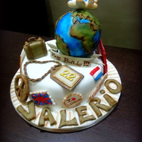 Travel Cake This cake was made for the birthday of a boy lover of travel, leaving for London and Amsterdam. Everything is completely edible and...