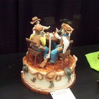 Western/cowboys The cake was covered with foundant ,the figurines and the details were made in gum paste. I used people molds for the figurines and I used...