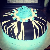 Birthday Cakes this cake was done for a 10 year old girl. She wanted a really big teal rose on top...
