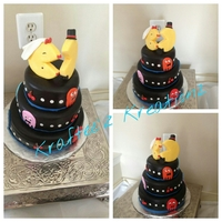 This Is My First Wedding Cake It Is A Mr Amp Mrs Pacman Wedding Cake It Is Covered In Fondant And The Toppers Are Made Of Fondant As We This is my first Wedding cake!!! It is a Mr & Mrs Pacman wedding cake it is covered in fondant and the toppers are made of fondant as...