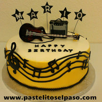 Electric Guitar Theme Cake Chocolate and vanilla cake with chocolate pudding.