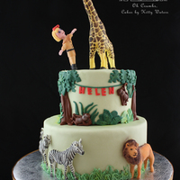 Zoo Birthday Cake My daughter loves the zoo and especially the giraffes so for her party we had to have a strawberry zoo cake! The giraffe and girl topper...