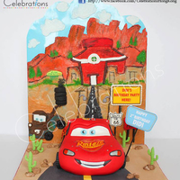 Mcqueen Car Cake We made this McQueen car cake with customised backdrop made of icing sugar and fondant details to give it a 3D look. Hope you all enjoy it...
