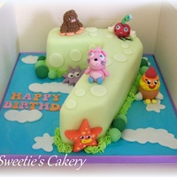 Moshi Monster Birthday Cakes   Moshi Monster themed green number 7 birthday cake with matching pink cupcakes.