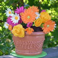 Flower Pot Cake Gumpaste flowers, fondant covered cake for pot and the dirt is crumbled cookies,