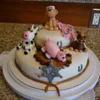 Farm Animal Birthday Cake Cake covered in fondant, animals are gumpaste, rocks are chocolate covered nuts