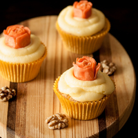 Carrot Cupcakes Topped With Carved Carrot Rose Carrot cupcakes topped with carved carrot rose.