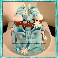 Baby Shower Cake - Boy  Baby shower two tier cake, bottom is marble nutalla, top is red velvet cream cheese, covered with fondant and topped with handmade blue...