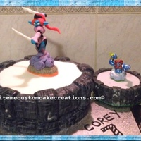 Skylanders Portal Cake Pictured With Actual Portal To The Right White Choc Mud Cake With Ganache Filling And Fondant Cover Topped With Han... Skylanders portal cake (pictured with actual portal to the right)White choc mud cake with ganache filling and fondant cover topped with...
