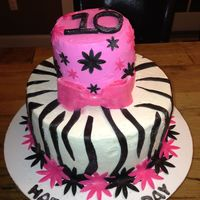 Zebra Stripe & Hot Pink Cake Accents made from modeling chocolate.