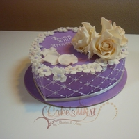 Violet Heart A romantic anniversary cake covered in fondant and piping decorated, Roses and petals in gumpaste. The design isn't mine but i...