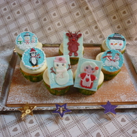 Sweet Winter! This is not my design. I think i saw them here on cc.All made with fondant and royal icing... Hope you like it...