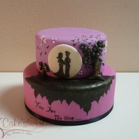 You Are The One... This cake was made and designed entirely by my lovely wife. The idea is that of two lovers suspended in nothing on a rocky soil. The pink...
