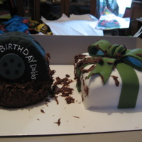Mud Tires And Presents This is a Birthday Cake a customer created for her boyfriend that loves to go mud ridding