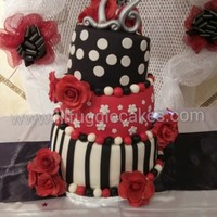 3 Tier Topsy Turvy Cake Each Tier Has A 3 Layer Cake With 2 Layers Of Filling This Was A Vanilla White Cake With Chocolate And Vanilla Cus... 3 tier Topsy Turvy Cake.Each tier has a 3 layer cake with 2 layers of filling. This was a vanilla white cake with chocolate and vanilla...