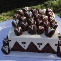 Square Grooms Cake With Tuxedo Strawberries Square groom's cake with tuxedo strawberries.