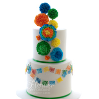 Mexican Cake Mexican themed cake for a very special 21st. The pom poms and ruffle flours are all made out of fondant as well as the Mexcian bunting. It...