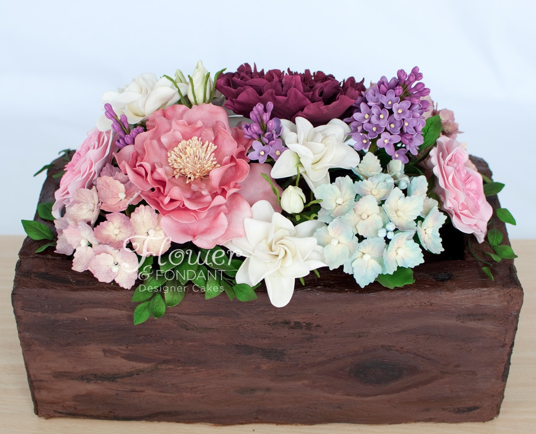 Flower Box Cake This flower box cake was for a very special lady. Open rose, David Austin roses, hydrangeas, gardenias, lilac & peony made up the...