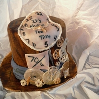 Alice In Wonderland - Mad Hatter This is my first entry ever and my inspiration when I thought of clocks was Alice in Wonderland. So I took the main base of the cake as a...