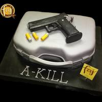 Gun 3D Cakes No we don't promote violence that's the name of the celebrant, seriously, and that's an edible STi Edge .45 mm edible pistol...