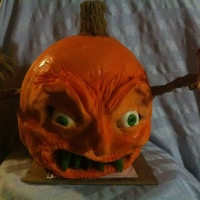Evil Pumpkin Goblin   modeling chocolate, pulled sugar teeth, gum paste eyes, severed finger.