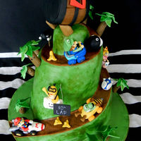 Mario Kart (Super Mario Bros) Fondant-gumpaste figures that are only about 1.5 inches high each. Mud cake on the bottom half, and RKT for the top (just for people we...