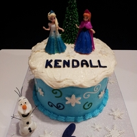 Frozen Disney Theme Birthday Cake Olaf Is Modeling Chocolate Sisters Are Toys Tree Is Ice Cream Cone And Buttercream Icing Purple Le Frozen Disney theme birthday cake. Olaf is modeling chocolate. Sisters are toys. Tree is ice cream cone and buttercream icing. Purple...