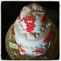 Cake For A Wedding Near The Sea... Cake for a wedding near the sea, with corals, shells, sea shells, sand beach... all natural colors where the protagonist is the reddish...