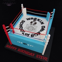 Boxing Ring Cake With a hand painted logo from the birthday boys former boxing club on top