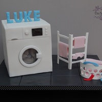 That Pesky Red Sock, It's Turned All My Washing Pink!  I made this for my sons birthday as he's obsessed with washing machines. The clothes dryer and the basket are pastillage, everything...