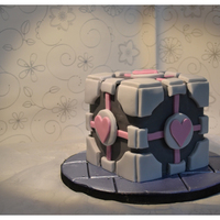 Companion Cube Birthday Cake  Companion Cube birthday cake. 5 inch cube made with 4 layers of white chocolate sponge and layered with vanilla buttercream and raspberry...