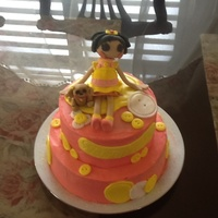 Laloopsy Try. This cake was for my girl, reason just because. Frosted with buttercream , doll made of gumpaste Andre dog, buttons out MMF. So happy with...