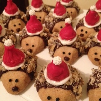 Santa Hedgehogs santa hedgehog shortbread cookies with candy melt-dipped kiss hats