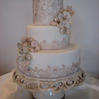 "Maggiean Elegant And Tasteful Wedding Cake With Elements Of Fondant Lace Gumpaste Blossoms And Gems *MAGGIE....an elegant and tasteful wedding cake with elements of fondant ""lace"", gumpaste blossoms and gems."