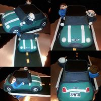 Mini Cooper Cake Modeled After The Retirees Actual Car And Thats Her And Her Husband   Mini Cooper cake, modeled after the retiree's actual car and that's her and her husband
