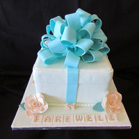"Farewell Cake: A ""tiffany"" Styled Gift Box Cake For A Farewell Function Three layered sponge cake with raspberry / strawberry filling covered in a pale green fondant with teal fondant ribbon detailing with ivory..."