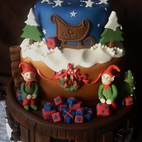 Christmas Is A-Coming And The Cakes Are Getting Iced! I couldn't decide if i wanted reindeer, elves, presents, snow, a sledge or a starry sky for our window display cake this year, so i...