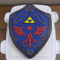 Legend Of Zelda: Twilight Princess Cake  A surprise cake for a good friend of mine who adores LOZ enough to tattoo it on her back~. It was a Sour Cream, vanilla-almond cake covered...